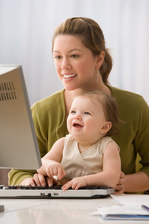 Mother and daughter using computer Stock Photo