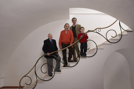 Multigenerational family on staircase, portrait