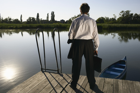 Businessman standing on Pier.