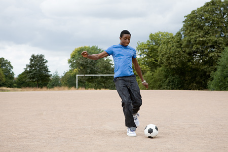 Teenage boy playing football