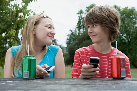 Teenage couple with cellphones