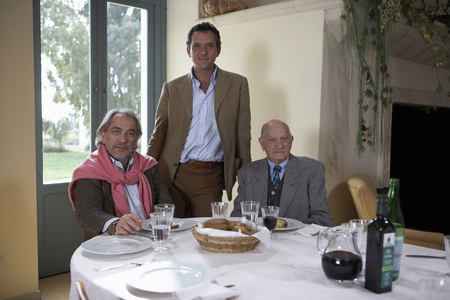 Three generation family at table, portrait