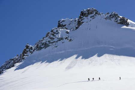 Silhouetted ski tourers on the mountain Stock Photo