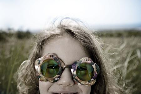 Girl wearing green sunglasses Stock Photo