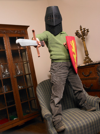 Boy wearing a knight costume Imagens