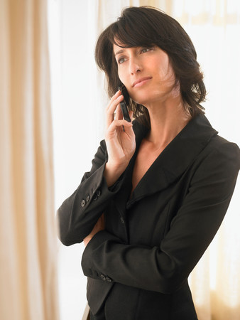 Woman with cell phone Stock Photo