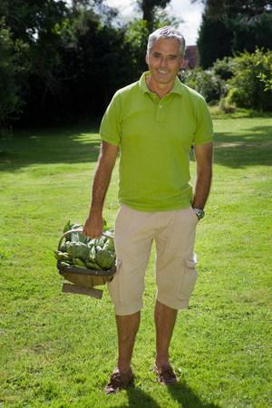 Portrait of  man with vegetable basket