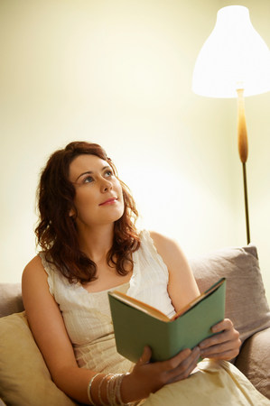 Young woman holding book