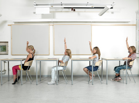 Four students in a classroom