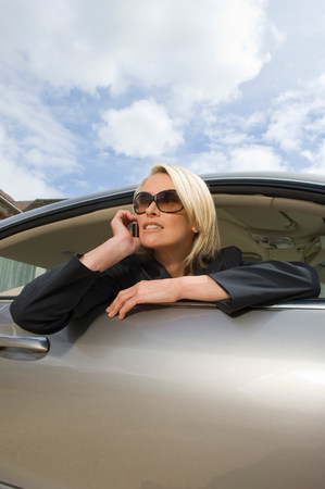 Business woman on phone in car Stock Photo