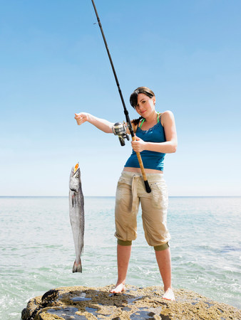 Young woman holding fish