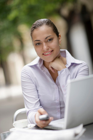Business woman at café with laptop Stock Photo