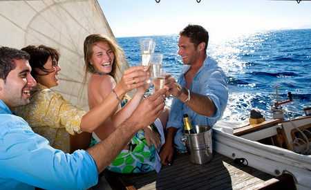 Two couples making a toast on sailboat