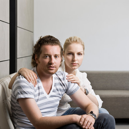 Man and woman in a living room