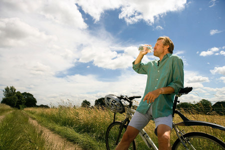 Cyclist drinking from a bottle of water