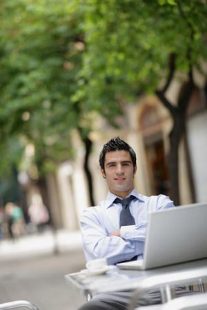 Business man at café with laptop Stock Photo