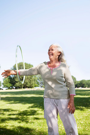 Mature woman with hula-hoop
