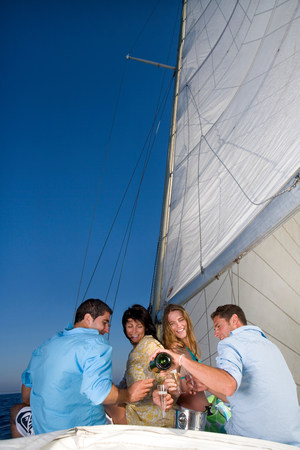 Couples making a toast on sailboat