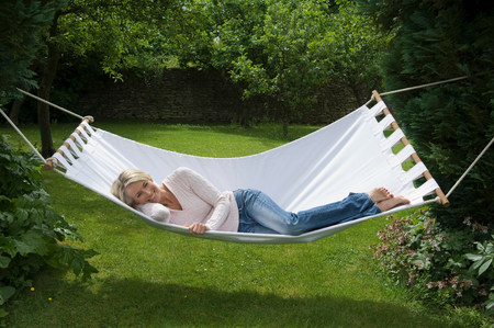 Smiling woman relaxing in hammock