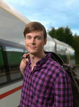 Young man on train station Stock Photo
