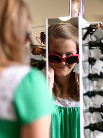 Girl trying sun glasses Stock Photo