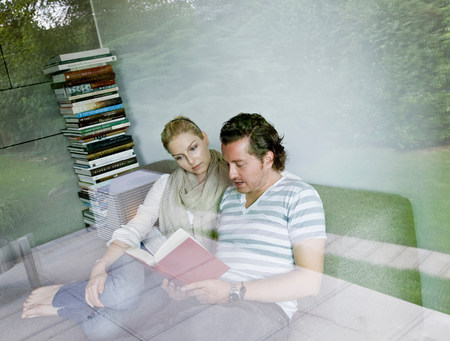 Man and woman reading together