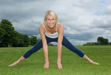 Smiling woman in park exercising