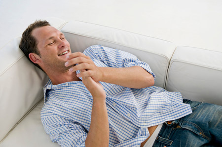A man lying on sofa