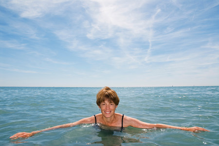 A woman in the sea smiling
