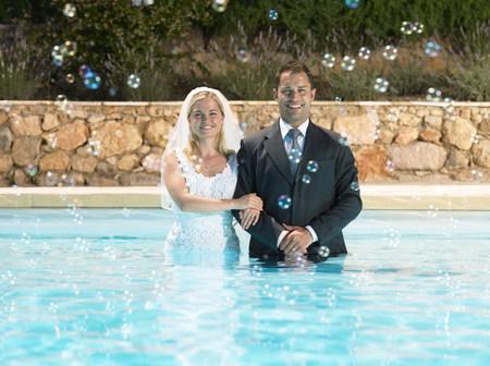 Bride and groom in pool