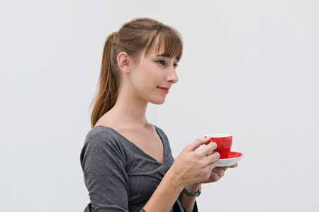 Female holding a red cup.