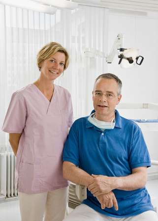 Portrait of a male dentist and assistant