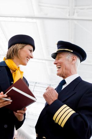 Flight personnel smiling