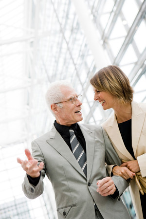 Older man talking to younger woman