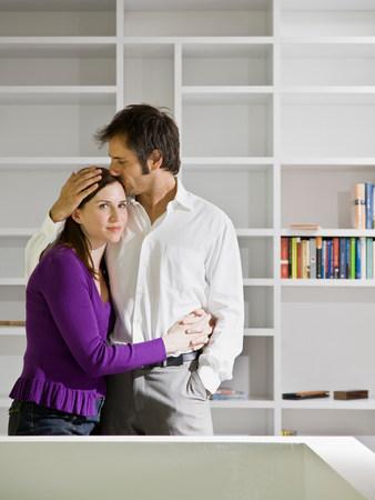 Man and woman embracing Stock Photo