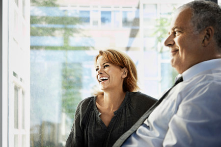 Man and woman smiling, business
