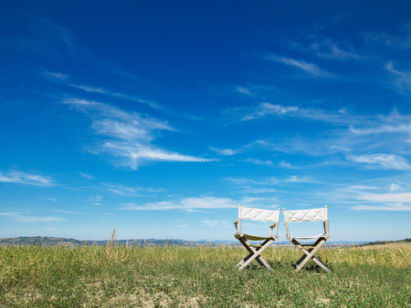 Two seats in front of landscape
