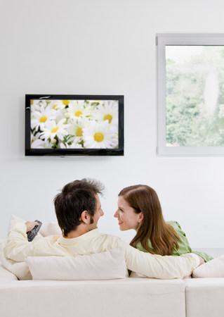 Man and woman watching television