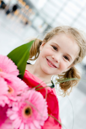 Girl smiling holding flowers