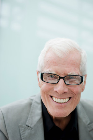 Older man smiling at viewer