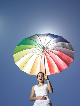 Girl holding sun parasol