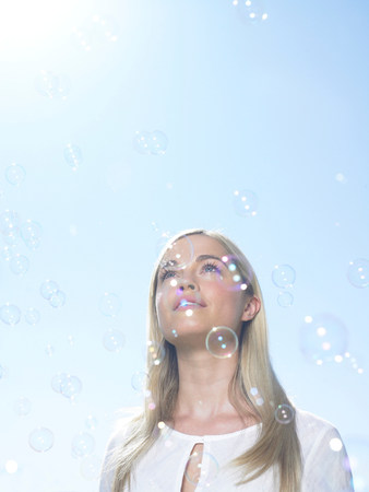 Girl looking at sky with bubbles