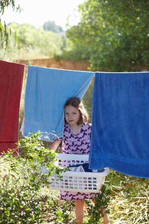 Young girl carrying the washing
