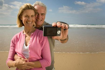 Couple taking photograph on a beach