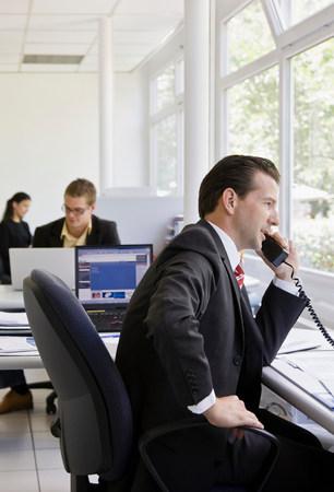 Workers in busy office Reklamní fotografie