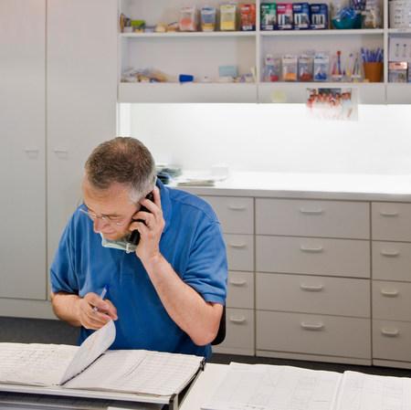 Male dentist talking on a phone