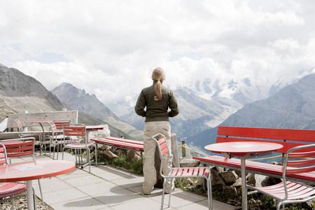 girl using binocular to view mountains