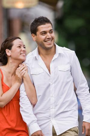 Couple walking down street Stock Photo