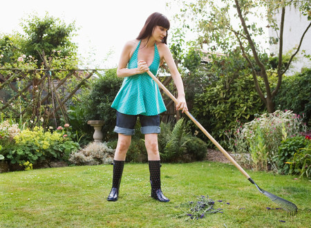 Woman raking lawn