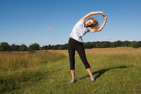 Woman runner doing stretching exercises